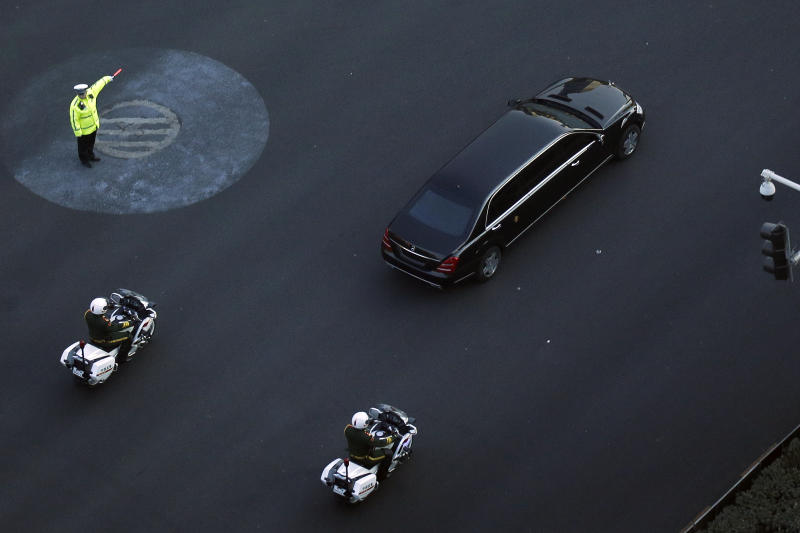 A traffic policeman shows direction to a Mercedes limousine with a golden emblem, similar to one North Korean leader Kim Jong Un has used previously, is escorted by motorcades traveling past Chang'an Avenue in Beijing, Wednesday, Jan. 9, 2019. North Korean state media reported Tuesday that Kim is making a four-day trip to China in what's likely an effort by him to coordinate with his only major ally ahead of a summit with U.S. President Donald Trump that could happen early this year. (AP Photo/Andy Wong)