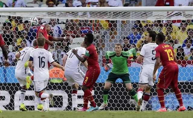 Ghana's Andre Ayew, top left, scores his side's first goal during the group G World Cup soccer match between Germany and Ghana at the Arena Castelao in Fortaleza, Brazil, Saturday, June 21, 2014. (AP Photo/Matthias Schrader)