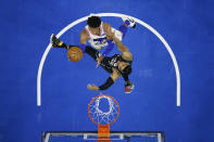 Philadelphia 76ers' Matisse Thybulle, top, goes up for a shot against Brooklyn Nets' Bruce Brown during the first half of an NBA basketball game, Wednesday, April 14, 2021, in Philadelphia. (AP Photo/Matt Slocum)