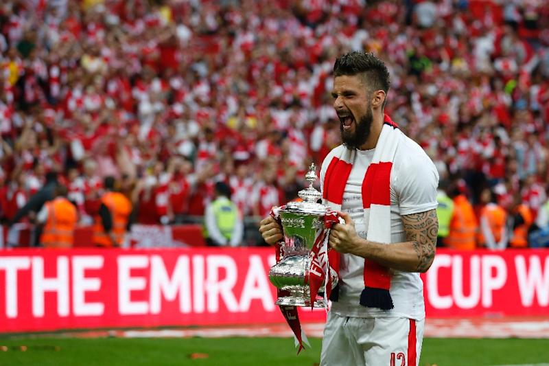 Arsenal39s Striker Olivier Giroud Celebrates With The FA Cup Trophy As Arsenal