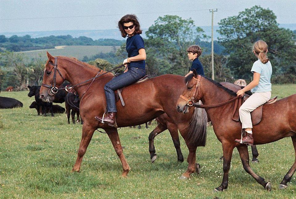 <p>Jacqueline and her children, Caroline and John Jr., appear at a press conference on horseback during a six-week vacation in Ireland.</p>