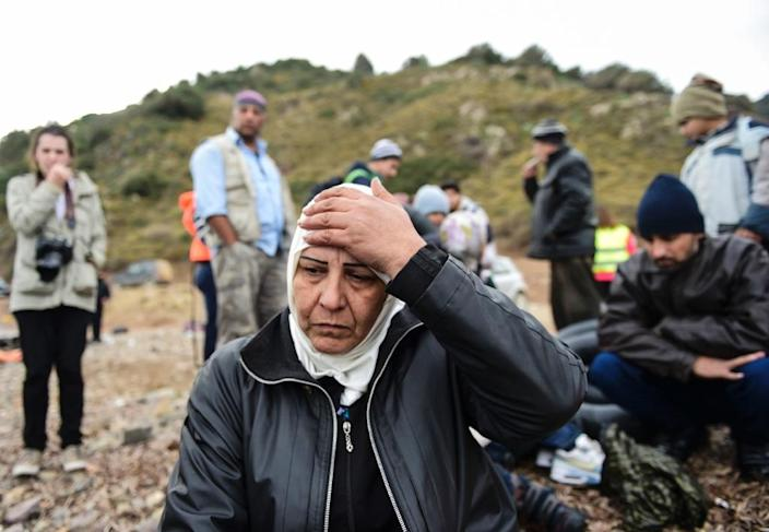Syrian refugees wait just after their arrival on the Greek island of Lesbos after crossing the Aegean Sea from Turkey on November 16 (AFP Photo/Bulent Kilic)