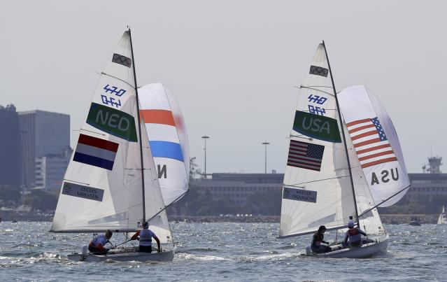 2016 Rio Olympics - Sailing - Final - Women's Two Person Dinghy - 470 - Medal Race - Marina de Gloria - Rio de Janeiro, Brazil - 18/08/2016. Anne Haeger (USA) of USA and Briana Provancha (USA) of USA and Afrodite Zegers-Kyranakou (NED) of Netherlands and Anneloes van Veen (NED) of Netherlands compete. REUTERS/Brian Snyder FOR EDITORIAL USE ONLY. NOT FOR SALE FOR MARKETING OR ADVERTISING CAMPAIGNS.