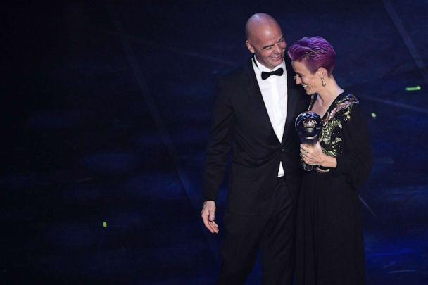 PHOTO: FIFA President Gianni Infantino (L) presents Megan Rapinoe with the trophy for the Best FIFA Women's Player of 2019 Award during The Best FIFA Football Awards ceremony, on September 23, 2019, in Milan. (Marco Bertorello/AFP/Getty Images)