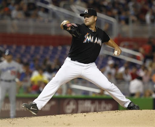 Miami Marlins starter Mark Buehrie pitches to the Los Angeles Dodgers during the third inning of a baseball game in Miami, Friday, Aug. 10, 2012. (AP Photo/J Pat Carter)