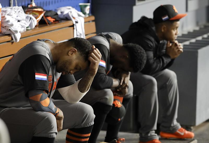 Netherlands left fielder Kalian Sams, left, sits on the bench after their loss to Puerto Rico in a semifinal in the World Baseball Classic in Los Angeles, Monday, March 20, 2017. (AP Photo/Chris Carlson)