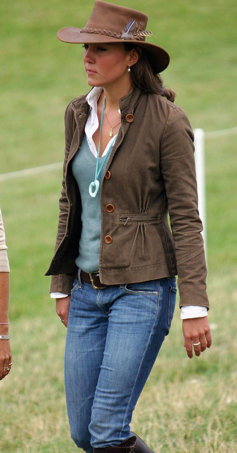 """<p>This picture is such a throwback that The Duchess is referred to as """"Kate Middleton, girlfriend of Prince William"""" in the Getty Images caption. Taken in 2005 at a festival in Tetbury, we love her early noughties faded low-rise jeans and big belt buckle. </p>"""