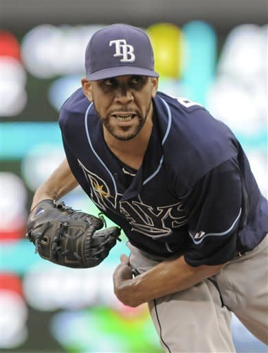 Tampa Bay Rays pitcher David Price follows through on a pitch against the Minnesota Twins in the first inning of a baseball game Saturday, Aug. 11, 2012 in Minneapolis. Price picked up his 15th win as the Rays beat the Twins 4-2. (AP Photo/Jim Mone)