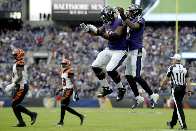 Baltimore Ravens offensive tackle Ronnie Stanley, left, and quarterback Lamar Jackson celebrate Jackson's touchdown run against the Cincinnati Bengals during the first half of a NFL football game Sunday, Oct. 13, 2019, in Baltimore. (AP Photo/Gail Burton)