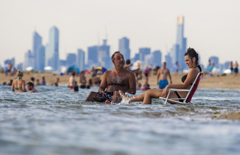 Melbourne's Brighton Beach is expected to get a workout before the temperatures drop away later in the day. Image: AP
