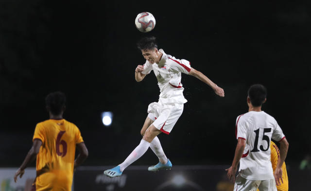 North Korea's Kuk Chol, center, heads the ball during the World Cup Group H Asia qualifying soccer match between Sri Lanka and North Korea in Colombo, Sri Lanka, Tuesday, Sept. 10, 2019. North Korea defeated Sri Lanka by 1-0. (AP Photo/Eranga Jayawardena)