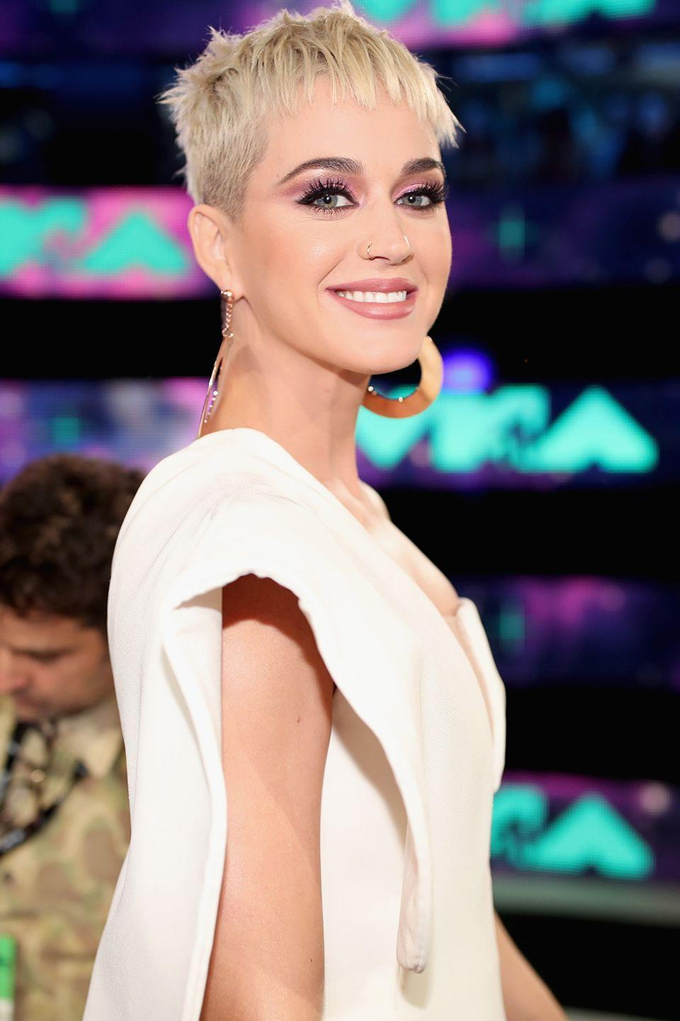 """<p><strong>Born</strong>: Katheryn Elizabeth Hudson</p><p>The """"I Kissed A Girl"""" singer explains that her stage name came about during her adolescent identity crisis. """"I created this wonderful character called Katy Perry that I very much am, and can step into all the time, but I created that character out of protection,"""" the singer told <em><a href=""""https://www.theguardian.com/music/2017/jun/11/katy-perry-interview-witness-album-glastonbury"""" rel=""""nofollow noopener"""" target=""""_blank"""" data-ylk=""""slk:The Guardian"""" class=""""link rapid-noclick-resp"""">The Guardian</a></em>. </p><p>""""It was me going, 'OK, I've been upset my whole childhood so I'm going to show the world I am something, that I am going to do something and that I am enough,'"""" Perry <a href=""""https://www.theguardian.com/music/2017/jun/11/katy-perry-interview-witness-album-glastonbury"""" rel=""""nofollow noopener"""" target=""""_blank"""" data-ylk=""""slk:continued"""" class=""""link rapid-noclick-resp"""">continued</a>. """"I didn't want to be Katheryn Hudson. I hated that, it was too scary for me, so I decided to be someone else.""""</p>"""