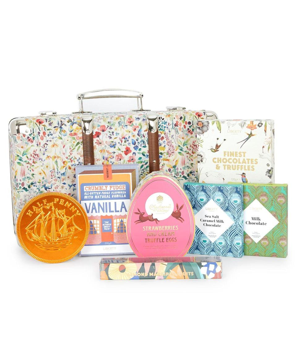 "<p>If a chocolate egg isn't really your thing, the Liberty-print suitcase hamper is a winner. The keepsake is filled with all sorts of British fare, from Pump Street milk chocolate to Prestat truffles, buttermilk vanilla fudge and some lovely marzipan fruits. </p><p>£99, <a href=""https://www.libertylondon.com/uk/department/gifts/by-occasion/easter-gifts/"" rel=""nofollow noopener"" target=""_blank"" data-ylk=""slk:Liberty London"" class=""link rapid-noclick-resp"">Liberty London</a>.</p><p><a class=""link rapid-noclick-resp"" href=""https://go.redirectingat.com?id=127X1599956&url=https%3A%2F%2Fwww.libertylondon.com%2Fuk%2Fdepartment%2Fgifts%2Fby-occasion%2Feaster-gifts%2F&sref=https%3A%2F%2Fwww.townandcountrymag.com%2Fuk%2Flifestyle%2Ffood-and-drink%2Fg35722260%2Fbest-luxury-easter-eggs%2F"" rel=""nofollow noopener"" target=""_blank"" data-ylk=""slk:SHOP NOW"">SHOP NOW</a><br></p>"