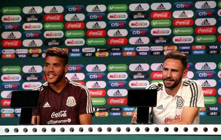 Soccer Football - World Cup - Mexico Press Conference - Mexico Training Camp, Moscow, Russia - June 18, 2018 Mexico's Jonathan dos Santos and Miguel Layun during the press conference REUTERS/Albert Gea