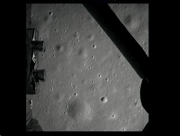 The first photo of the moon by China's Chang'e 3 lunar lander is shown here in this still from a broadcast by the country's state-run CNTV news channel on Dec. 14, 2013. Chang'e 3 delivered the Yutu rover to the moon with its successful landing