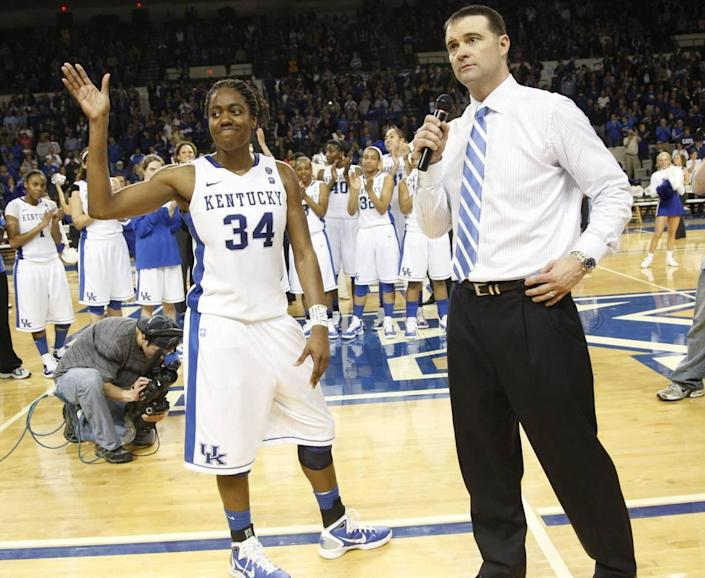 """Kentucky star Victoria Dunlap waved to the crowd along with head coach Matthew Mitchell after UK beat Arkansas 55-54 on its 2011 Senior Night. The biggest thing that turned around Wildcats women's hoops was """"Victoria Dunlap's ability to shine"""" in the up-tempo system Kentucky adopted in 2009-10, Mitchell says."""