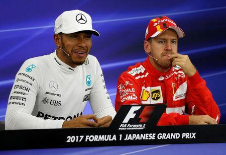 Formula One F1 - Japanese Grand Prix 2017 - Suzuka Circuit, Japan - October 7, 2017. Mercedes' Lewis Hamilton of Britain attends a news conference after getting pole position in qualifying with Ferrari's Sebastian Vettel of Germany. REUTERS/Toru Hanai