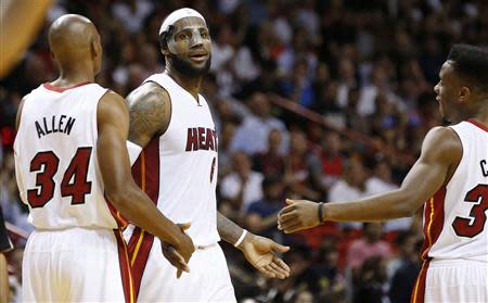 Mar 3, 2014; Miami, FL, USA; Miami Heat small forward LeBron James (6) is congratulated by Miami Heat shooting guard Ray Allen (34) and Miami Heat point guard Norris Cole in the second half of a game against the Charlotte Bobcats at American Airlines Arena. Robert Mayer-USA TODAY Sports