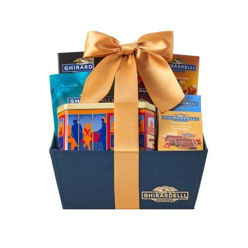 """<p><strong>ghirardelli</strong></p><p>ghirardelli.com</p><p><strong>$69.95</strong></p><p><a href=""""https://go.redirectingat.com?id=74968X1596630&url=https%3A%2F%2Fwww.ghirardelli.com%2Fgifts%2Fall-gifts%2Fbaskets%2Fsignature-chocolate-gift-basket-85046&sref=https%3A%2F%2Fwww.countryliving.com%2Fshopping%2Fgifts%2Fg19663932%2Fmothers-day-gift-baskets%2F"""" rel=""""nofollow noopener"""" target=""""_blank"""" data-ylk=""""slk:Shop Now"""" class=""""link rapid-noclick-resp"""">Shop Now</a></p><p>If your mom's a chocaholic, this is the gift basket for her. Or should we say """"gift <em>tower</em>""""?</p>"""