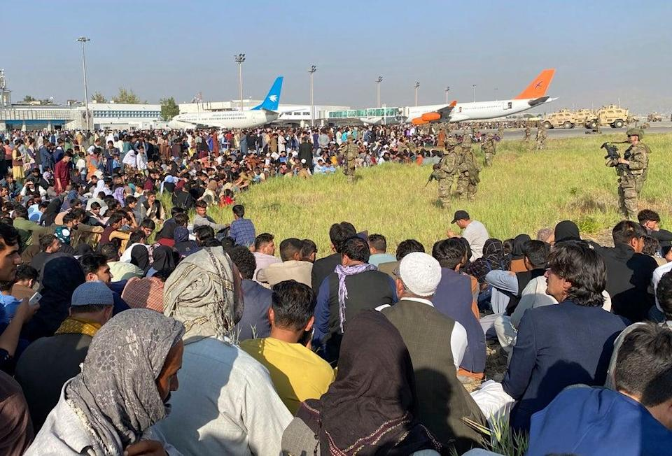 Crowds of people have travelled to the airport in Kabul hoping for a way out of the country (Shekib Rahmani/AP) (AP)