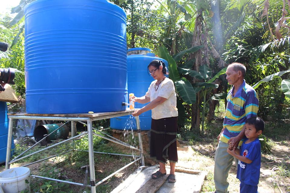 Julinah Koyou and Joseph Peter Gintak at their home with their newly installed tank. — Picture by Julia Chan