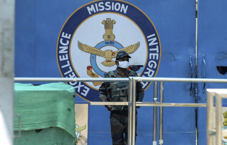 An Indian army soldier stands guard at the main gate of Jammu air force station after two suspected blasts were reported early morning in Jammu, India, Sunday, June 27, 2021. Indian officials said Sunday they suspected explosives-laden drones were used to attack the air base in the disputed region of Kashmir, calling it the first such incident of its kind in India. (AP Photo/Channi Anand)