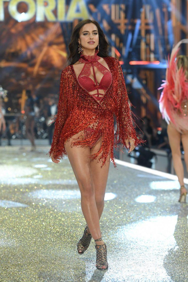Doesn't this red ensemble as seen on Irina Shayk look like an outfit Jennifer Lopez would wear? (Photo: Getty Images)