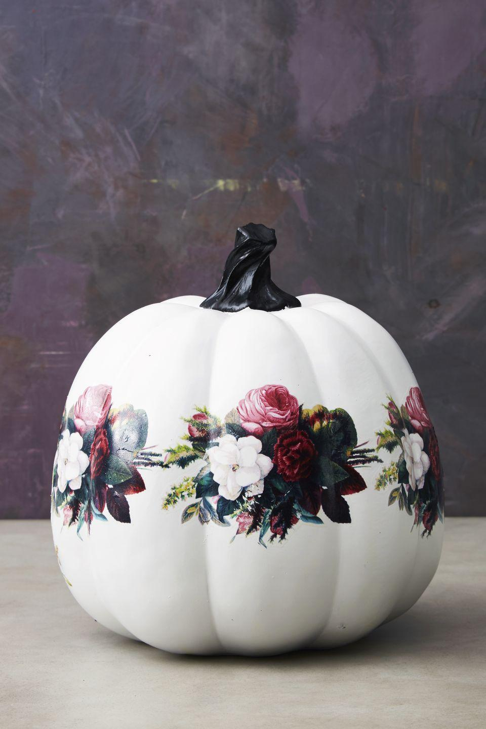 """<p>Adhere temporary tattoos to your white pumpkin, as you would on skin. Join a ring of floral selects together for this botanical look.</p><p><a class=""""link rapid-noclick-resp"""" href=""""https://go.redirectingat.com?id=74968X1596630&url=https%3A%2F%2Fwww.etsy.com%2Flisting%2F505906520%2Ftemporary-tattoo-purple-flower-purple&sref=https%3A%2F%2Fwww.goodhousekeeping.com%2Fholidays%2Fhalloween-ideas%2Fg1714%2Fno-carve-pumpkin-decorating%2F"""" rel=""""nofollow noopener"""" target=""""_blank"""" data-ylk=""""slk:SHOP TATTOOS"""">SHOP TATTOOS</a><br></p>"""