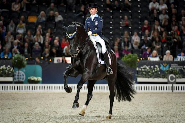 Equestrian - Sweden International Horse Show - Fei Grand Prix Dressage Qualification Event - Friends Arena, Stockholm, Sweden - December 2, 2017. Therese Nilshagen of Sweden rides her horse Dante Weltino OLD. TT News Agency/Jessica Gow via REUTERS ATTENTION EDITORS - THIS IMAGE WAS PROVIDED BY A THIRD PARTY. SWEDEN OUT. NO COMMERCIAL OR EDITORIAL SALES IN SWEDEN