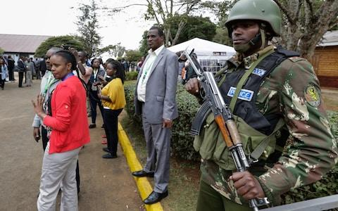 A police officer stands guard at the national tallying centre as Kenyans await the announcement on Friday - Credit: EPA