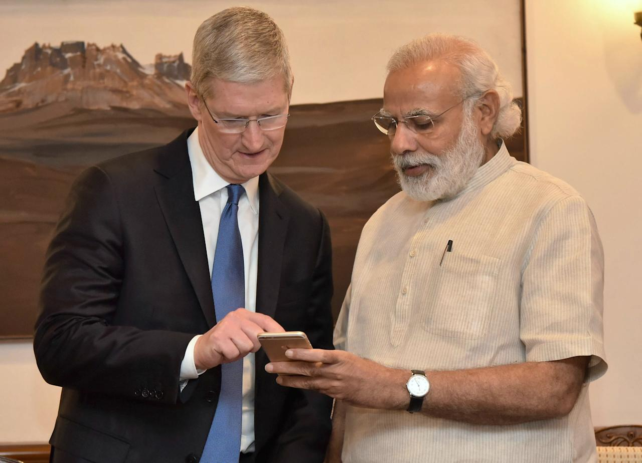 "In this photo released by the Press Information Bureau of India, Indian Prime Minister Narendra Modi, right, meets Apple CEO Tim Cook, in New Delhi, India, Saturday, May 21, 2016. Apple CEO Tim Cook laid out his company's plans for the vast Indian market in a meeting Saturday with Prime Minister Narendra Modi, who in turn sought Apple's support for his ""Digital India"" initiative focusing on e-education, health and increasing farmers' incomes. (AP Photo/Press Information Bureau of India)"