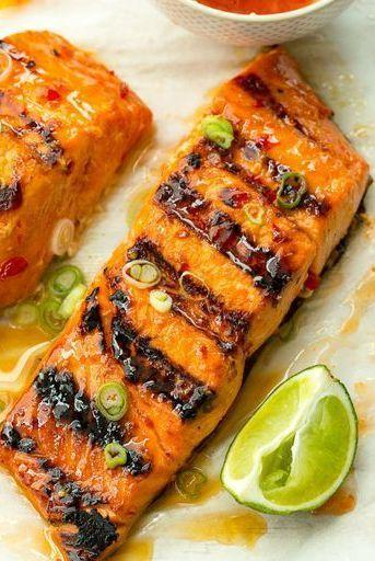 """<p>Amp up your grill game with this zesty glazed salmon.</p><p>Get the <a href=""""https://www.delish.com/uk/cooking/recipes/a29205051/sweet-chili-lime-grilled-salmon-recipe/"""" rel=""""nofollow noopener"""" target=""""_blank"""" data-ylk=""""slk:Sweet Chilli-Lime Grilled Salmon"""" class=""""link rapid-noclick-resp"""">Sweet Chilli-Lime Grilled Salmon</a> recipe.</p>"""