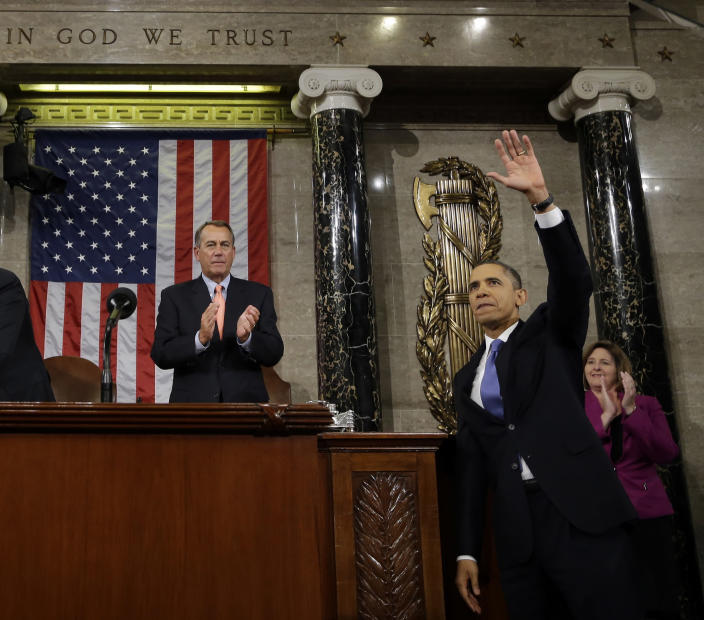 FILE - In this Feb. 12, 2013, file photo, President Barack Obama waves and House Speaker John Boehner of Ohio applauds after the president gave his State of the Union address during a joint session of Congress on Capitol Hill in Washington. (AP Photo/Charles Dharapak, Pool)