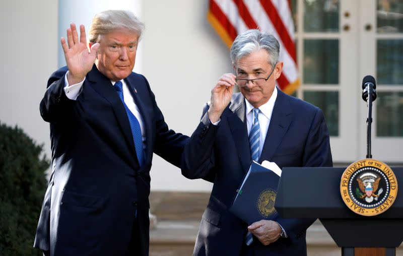FILE PHOTO: U.S. President Donald Trump gestures with Jerome Powell, his nominee to become chairman of the U.S. Federal Reserve at the White House in Washington