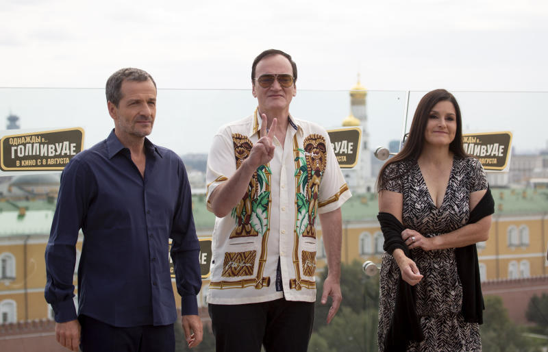 American writer and film director Quentin Tarantino, center, with producers David Heyman, left, and Shannon McIntosh, as they pose for photographers prior to the premiere of the movie 'Once Upon A Time in Hollywood' in Moscow, Russia, Wednesday, Aug. 7, 2019. (AP Photo/Alexander Zemlianichenko)