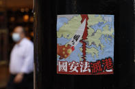 A sticker with a message against the national security law is left by protesters on a street in Hong Kong, Thursday, July 2, 2020. Hong Kong police have made the first arrests under a new national security law imposed by mainland China, as thousands of people defied tear gas and pepper pellets to protest against it. Police say they arrested 10 people under the law, including at least one who was carrying a Hong Kong independence flag. (AP Photo/Kin Cheung)