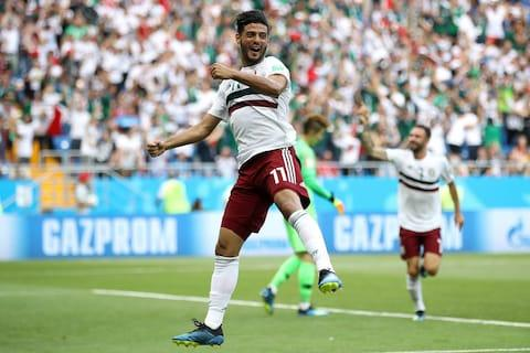Carlos Vela celebrates scoring from the spot - Credit: Clive Brunskill/Getty Images