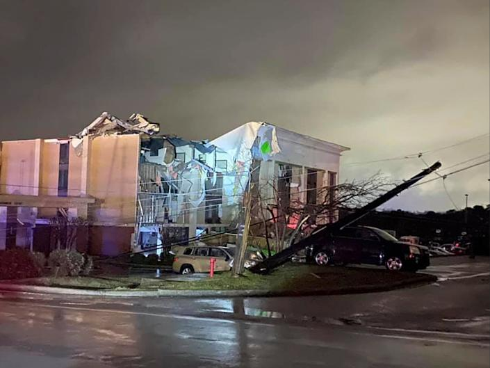 <p>A Hampton Inn hotel is severely damaged after a tornado tore through Fultondale, Alabama, on Monday 25 January 2021</p> ((Associated Press))