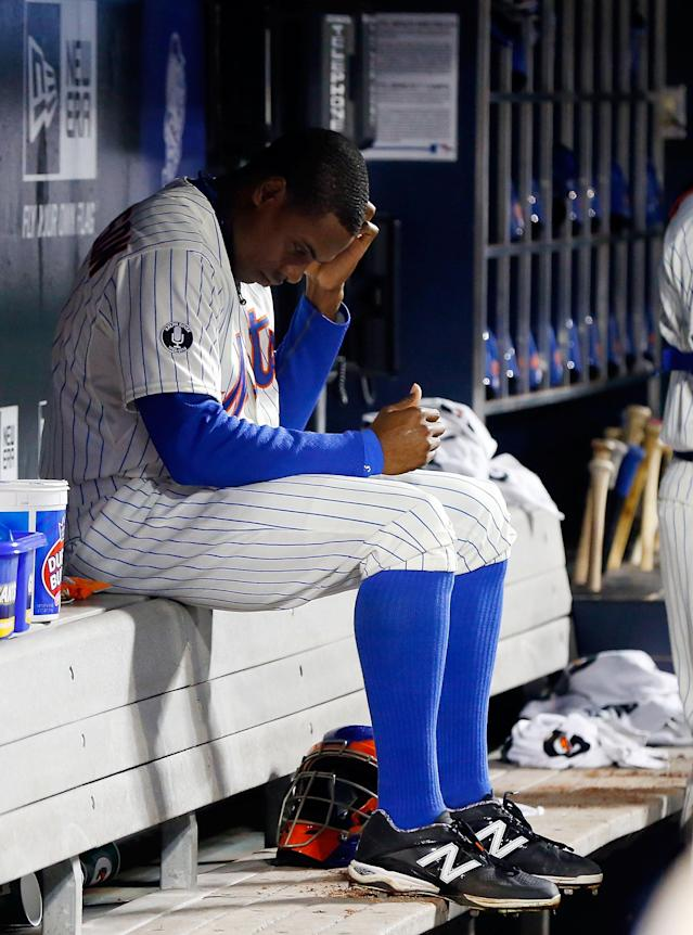 NEW YORK, NY - APRIL 22: Curtis Granderson #3 of the New York Mets sits in the dugout during the second inning against the St. Louis Cardinals at Citi Field on April 22, 2014 in the Flushing neighborhood of the Queens borough of New York City. (Photo by Jim McIsaac/Getty Images)