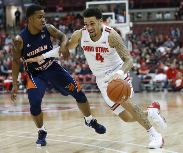 Ohio State's Duane Washington, right, drives to the basket against Morgan State's Isaiah Burke during the second half of an NCAA college basketball game Friday, Nov. 29, 2019, in Columbus, Ohio. Ohio State beat Morgan State 90-57. (AP Photo/Jay LaPrete)