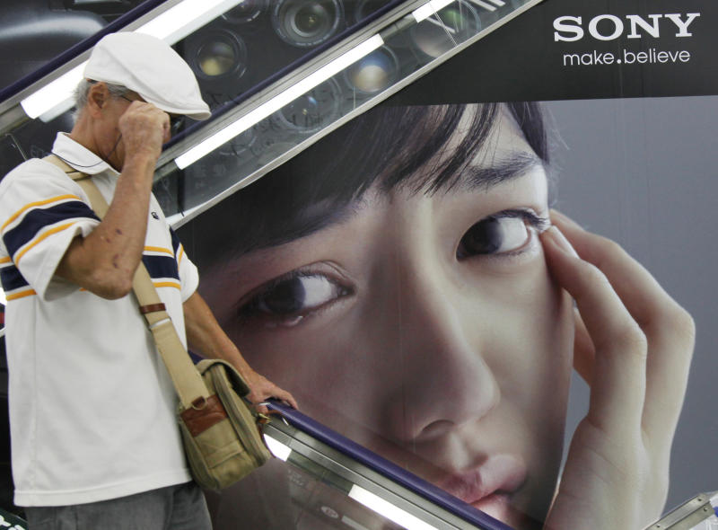 A shopper passes by an advertisement poster of Sony at a store in Tokyo, Thursday, Aug. 2, 2012.  Sony is reporting a bigger loss for the April-June quarter at 24.6 billion yen ($316 million) despite a sales recovery from a disaster-struck previous year. The Japanese electronics and entertainment company said Thursday its income was hurt by a surging yen, which erases overseas earnings, and by declining sales of liquid-crystal display TVs and video game machines. (AP Photo/Koji Sasahara)