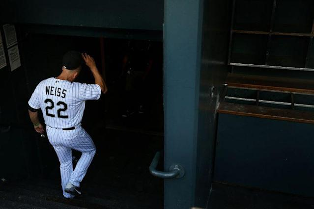 Walt Weiss walks out of the dugout and into the clubhouse for what would be the final time. (Getty Images)