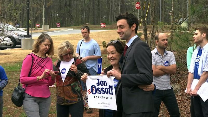 This March 27, 2017 photo shows Democratic congressional candidate Jon Ossoff with supporters outside of the East Roswell Branch Library in Roswell, Ga.  Five Democrats will appear on the ballot, but Ossoff is considered the greatest threat to the GOP. Two independent candidates also are running. (AP Photo/Alex Sanz)