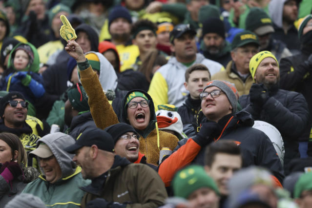 Oregon fans celebrate a touchdown by Oregon cornerback Mykael Wright (2) during the first half of an NCAA college football game in Eugene, Ore., Saturday, Nov. 30, 2019. (AP Photo/Amanda Loman)