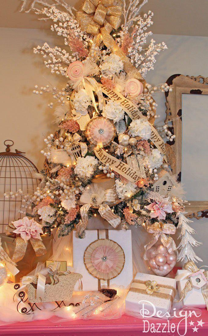 """<p>There's nothing shabby about a chic tree dressed up in shades of pink, cream, tan, and white. </p><p><strong><em>Get the tutorial at <a href=""""https://www.designdazzle.com/michaels-holiday-dream-tree-challenge-reveal/"""" rel=""""nofollow noopener"""" target=""""_blank"""" data-ylk=""""slk:Design Dazzle"""" class=""""link rapid-noclick-resp"""">Design Dazzle</a>. </em></strong></p><p><a class=""""link rapid-noclick-resp"""" href=""""https://www.amazon.com/wlflash-Christmas-Glitter-Streamer-Ornaments/dp/B07V21ZXJX?tag=syn-yahoo-20&ascsubtag=%5Bartid%7C10070.g.2025%5Bsrc%7Cyahoo-us"""" rel=""""nofollow noopener"""" target=""""_blank"""" data-ylk=""""slk:SHOP RIBBON TREE TOPPER"""">SHOP RIBBON TREE TOPPER</a></p>"""