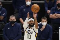 Utah Jazz guard Mike Conley (10) shoots a 3-pointer in the second half during an NBA basketball game against the Dallas Mavericks Wednesday, Jan. 27, 2021, in Salt Lake City. (AP Photo/Rick Bowmer)