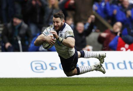 Britain Rugby Union - Scotland v Italy - Six Nations Championship - BT Murrayfield Stadium, Edinburgh, Scotland - 18/3/17 Scotland's Tommy Seymour (R) scores their fourth try Action Images via Reuters / Lee Smith Livepic