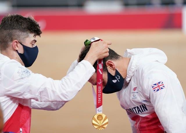 Jaco Van Gass, right, receives his gold medal from team-mate Fin Graham, who took silver