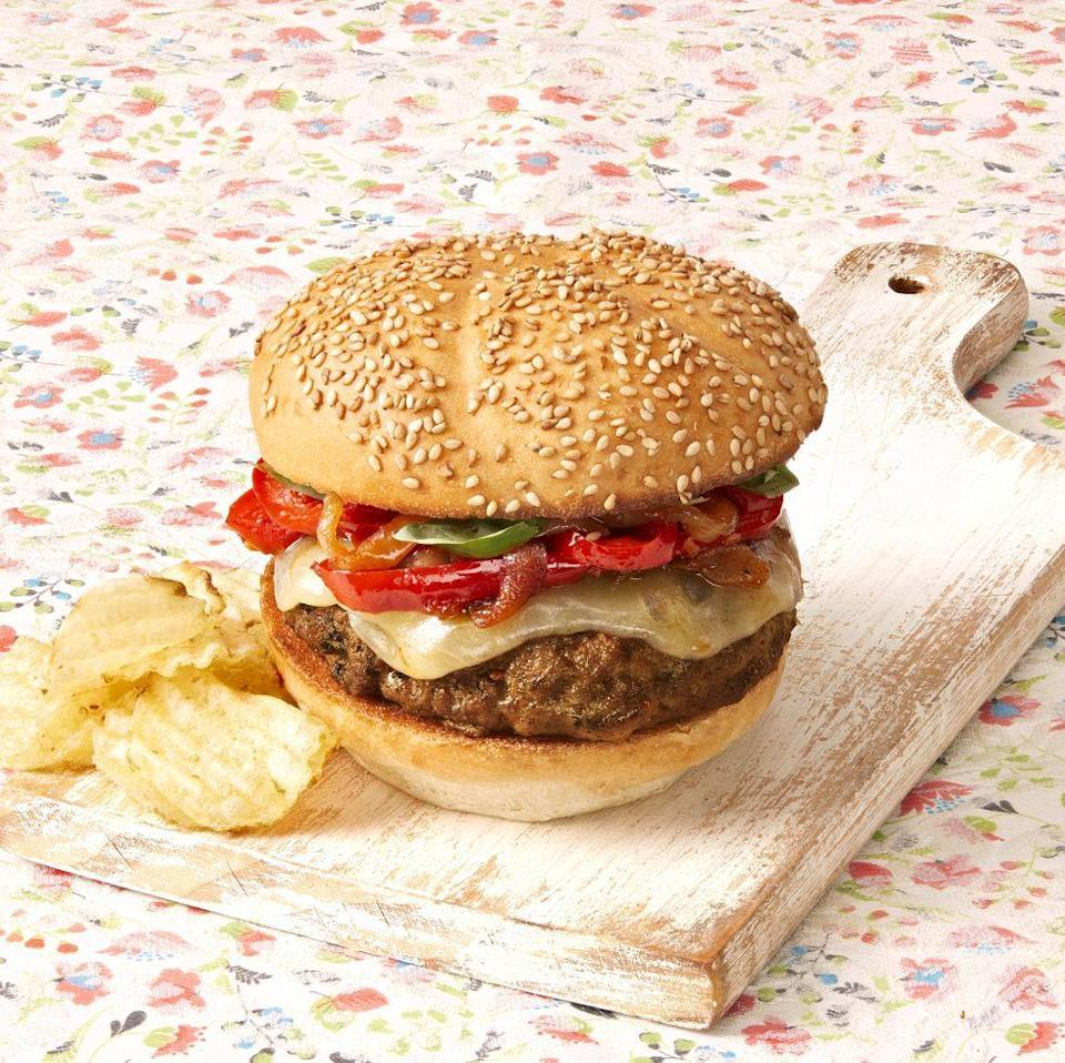 """<p>Cook down bell peppers, onions, and tomato sauce to make a delicious saucy topping for these grilled sausage and beef burgers. Gooey provolone cheese is the perfect finishing touch. </p><p><a href=""""https://www.thepioneerwoman.com/food-cooking/recipes/a34876039/sausage-and-peppers-burgers-recipe/"""" rel=""""nofollow noopener"""" target=""""_blank"""" data-ylk=""""slk:Get Ree's recipe."""" class=""""link rapid-noclick-resp""""><strong>Get Ree's recipe. </strong></a></p><p><a class=""""link rapid-noclick-resp"""" href=""""https://go.redirectingat.com?id=74968X1596630&url=https%3A%2F%2Fwww.walmart.com%2Fsearch%2F%3Fquery%3Dgrill%2Btools&sref=https%3A%2F%2Fwww.thepioneerwoman.com%2Ffood-cooking%2Fmeals-menus%2Fg37078352%2Fitalian-sausage-recipes%2F"""" rel=""""nofollow noopener"""" target=""""_blank"""" data-ylk=""""slk:SHOP GRILL TOOLS"""">SHOP GRILL TOOLS</a></p>"""