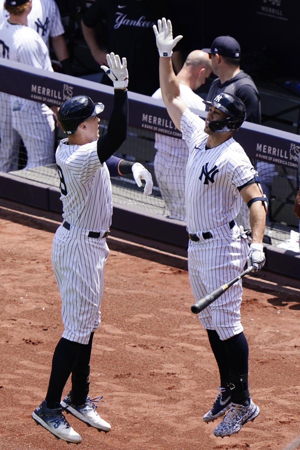 New York Yankees Aaron Judge, left, celebrates with on-deck batter and designated hitter Giancarlo Stanton during the first inning a baseball game against the Kansas City Royals, Thursday, June 24, 2021, at Yankee Stadium in New York. (AP Photo/Kathy Willens)